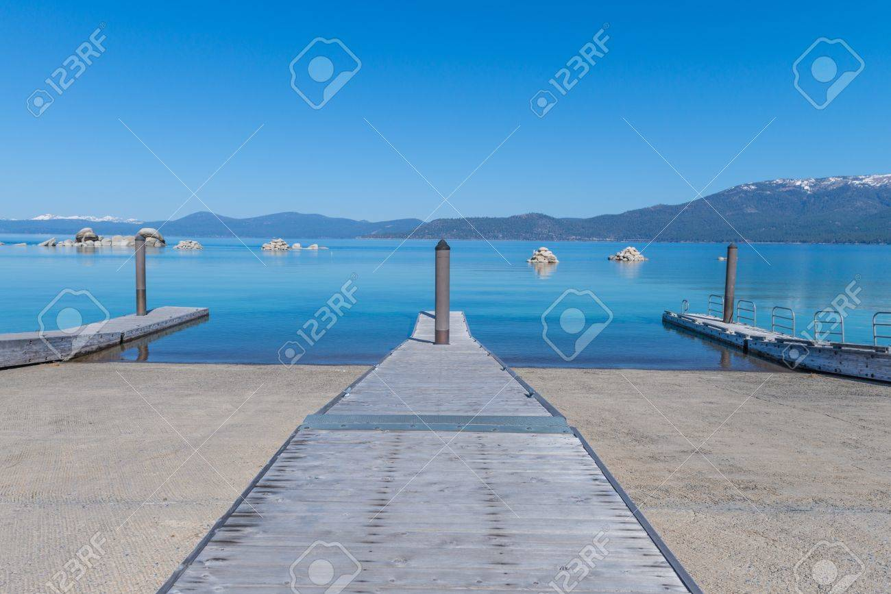 Beautiful blue clear water pier on the shore of the lake Tahoe Stock Photo - 19407907