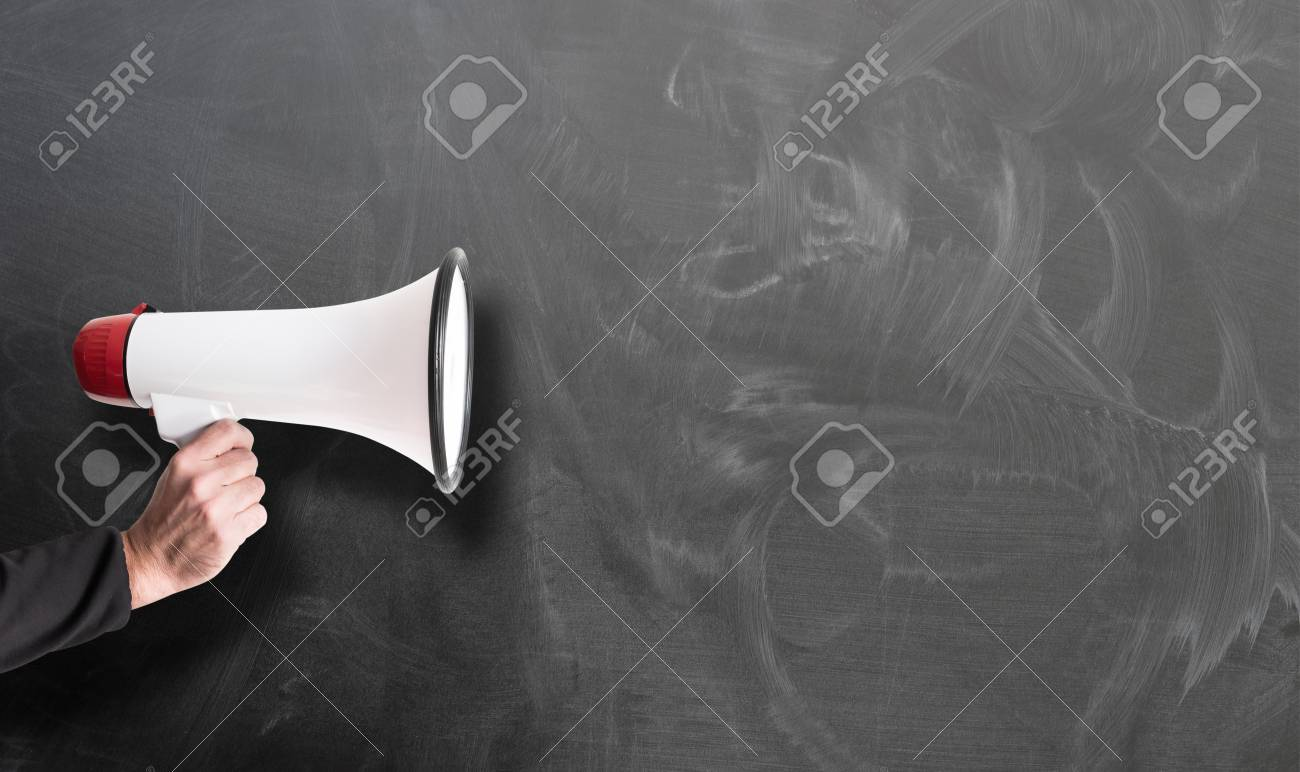 hand holding red and white megaphone against chalkboard template - 123379579