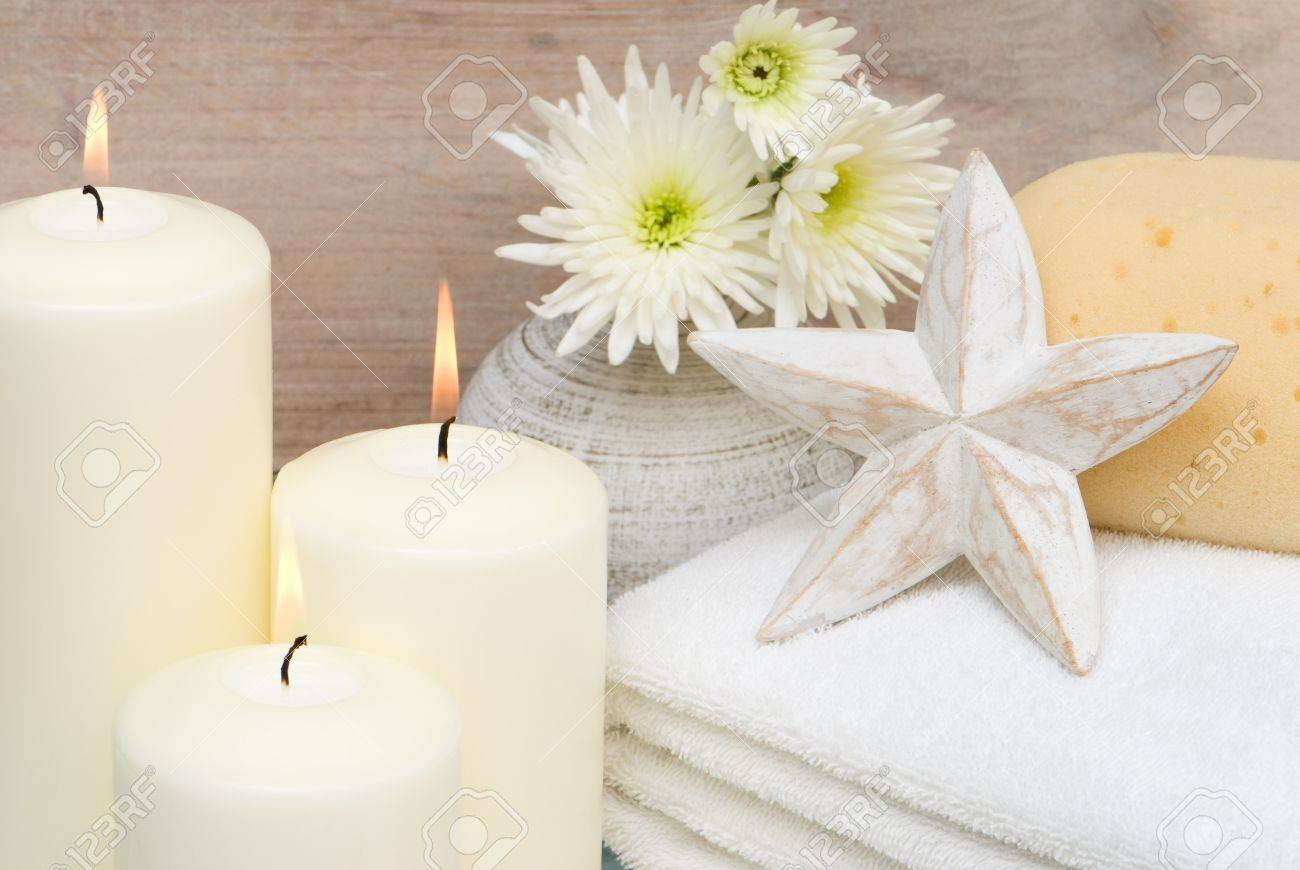 Lit Candles In Bathroom Setting With Fluffy Towels Stock Photo - Candles for bathroom