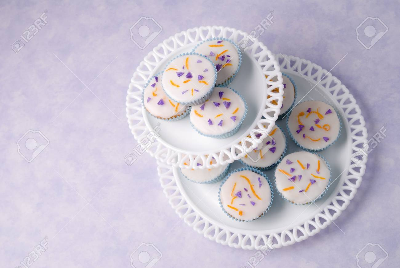 Pretty cupcakes on two tier glass stand Stock Photo - 4803911