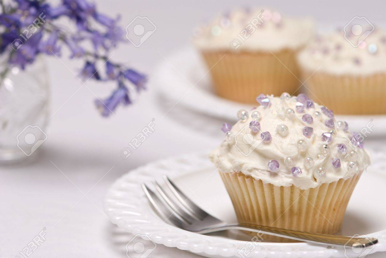 Pretty Cupcakes Decorated With Purple Sprinkles Vase Of Bluebell