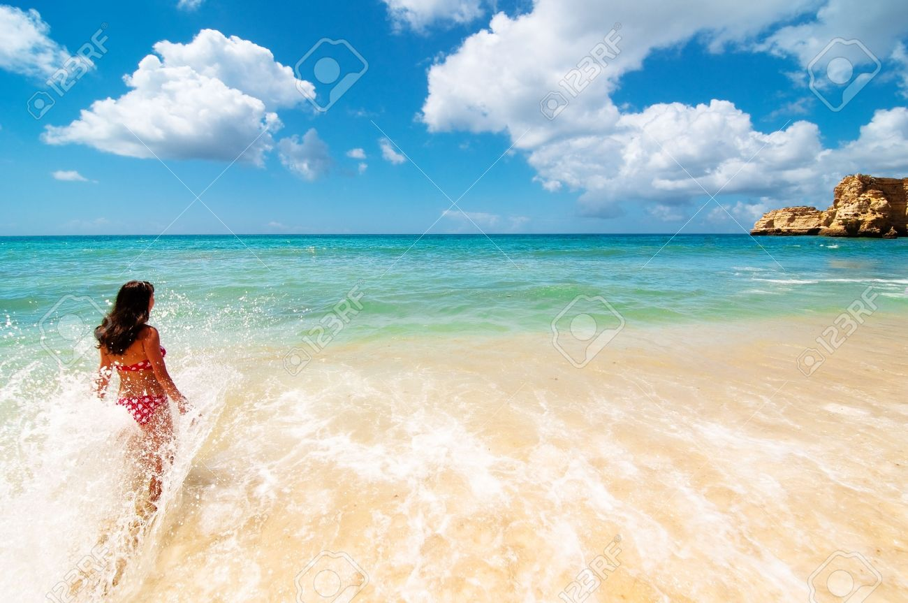 Girl Splashing In The Water At A Tropical Beach Paradise Stock Photo