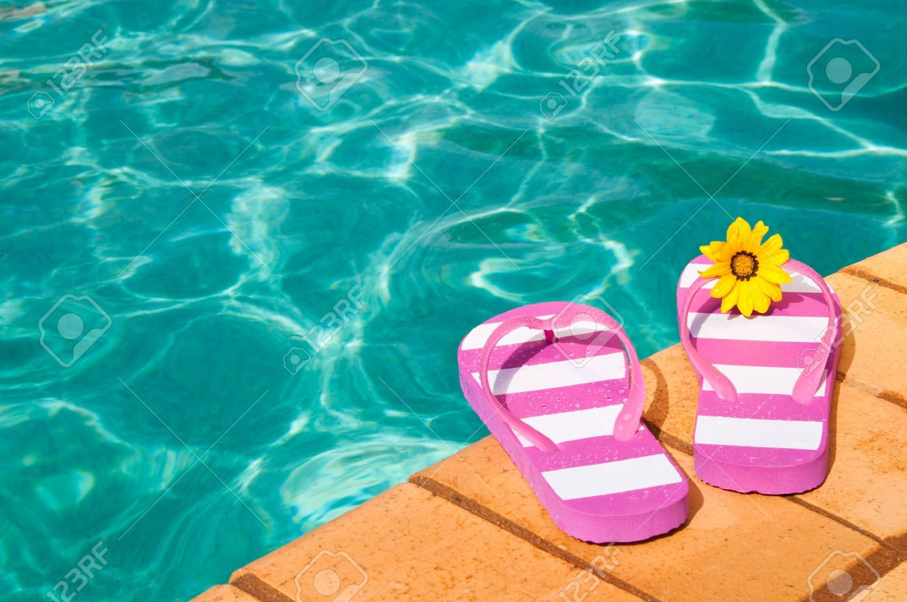 f43cca1ff660 Colorful summer flip flops by the side of luxury swimming pool with flower  Stock Photo -
