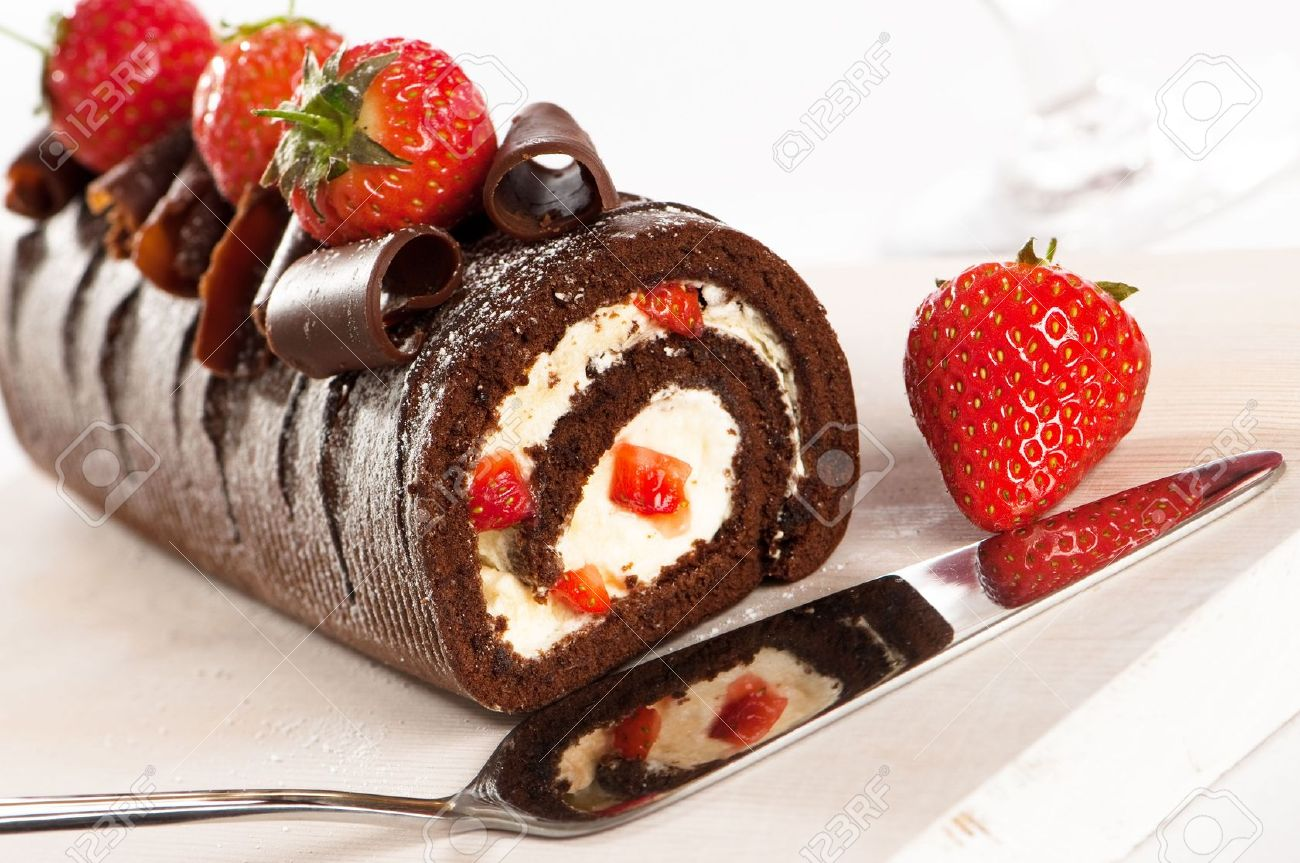Chocolate And Strawberry Gateaux With Serving Slice Reflection Of Cake In Cutter Stock Photo