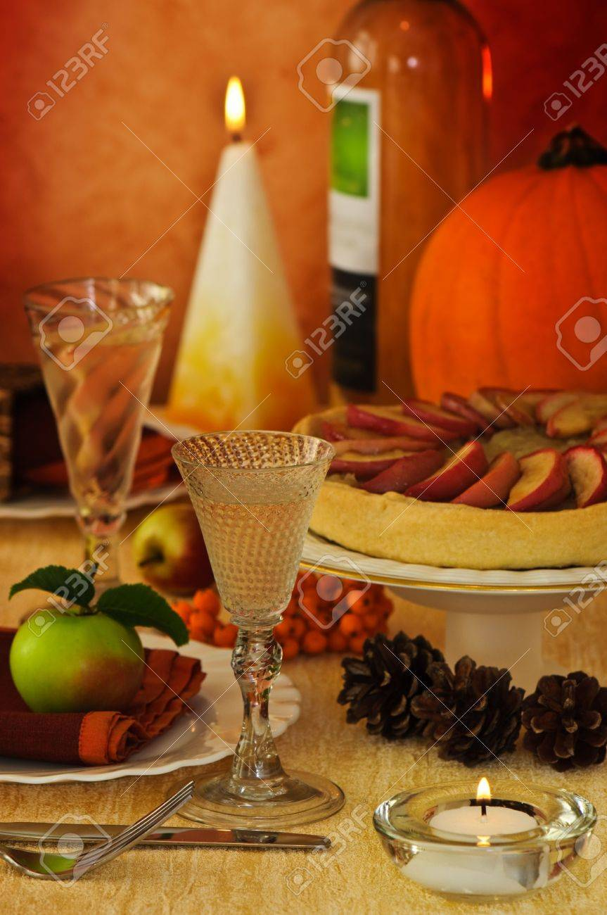Stock Photo - Thanksgiving harvest table setting with apple pie and pumpkin with wine & Thanksgiving Harvest Table Setting With Apple Pie And Pumpkin ...