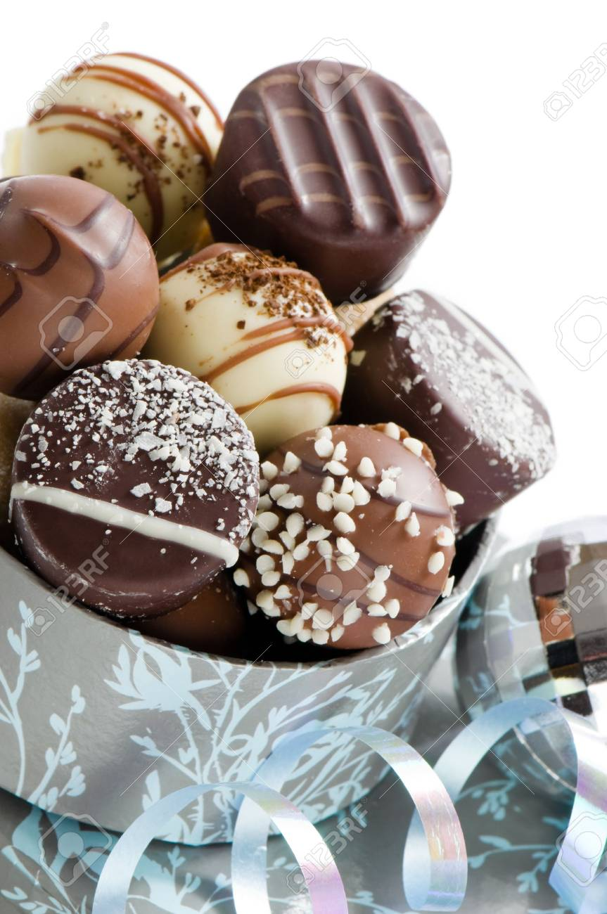 Close up of luxury Christmas chocolates with silver bauble and ribbon Stock Photo - 5767884