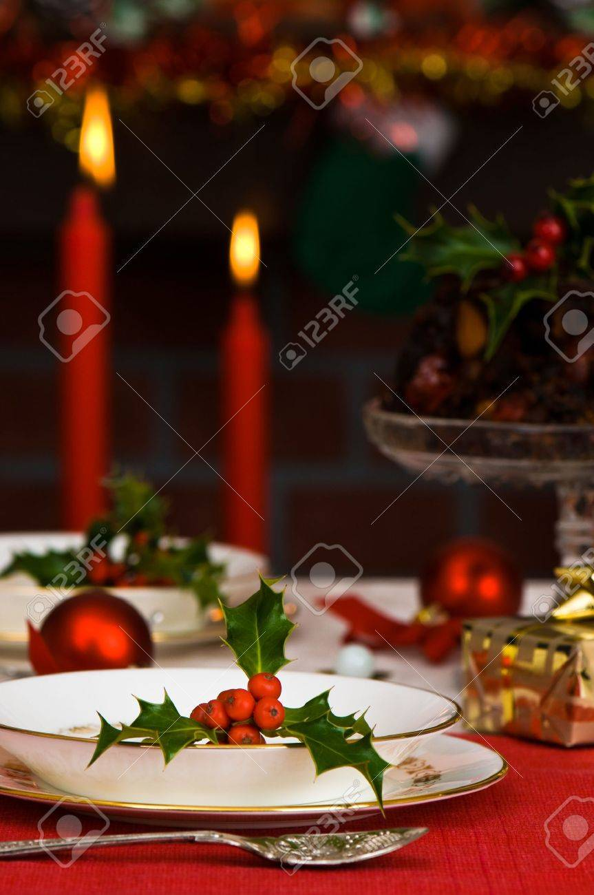 Festive Christmas table setting with lit candles and fireplace in background Stock Photo - 5806360