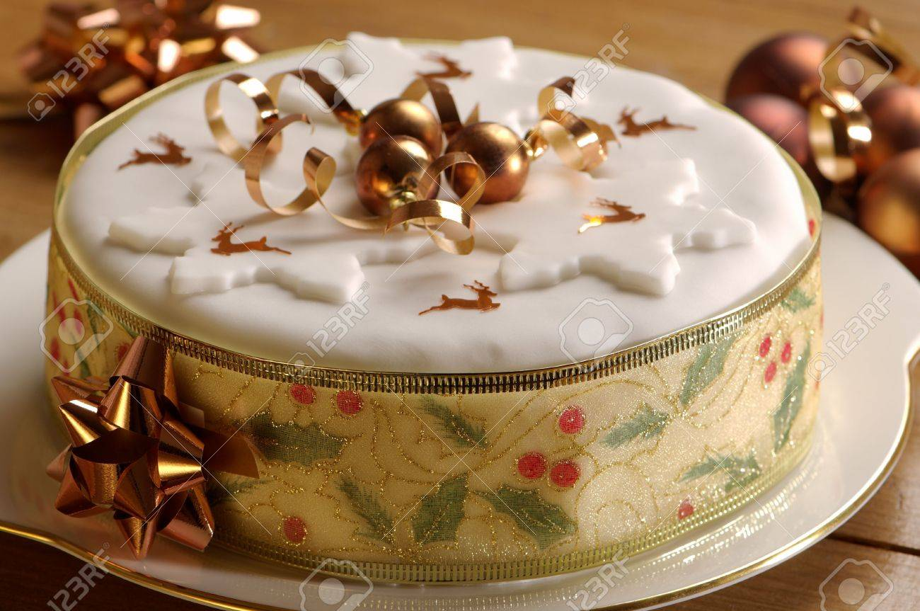 Festive Christmas cake decorated with gold baubles and reindeer confetti Stock Photo - 5972921