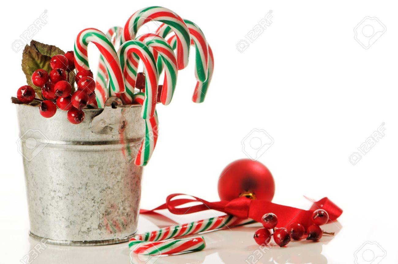 Christmas Candy Decorations.Bucket Of Festive Christmas Candy Canes With Decorations On White