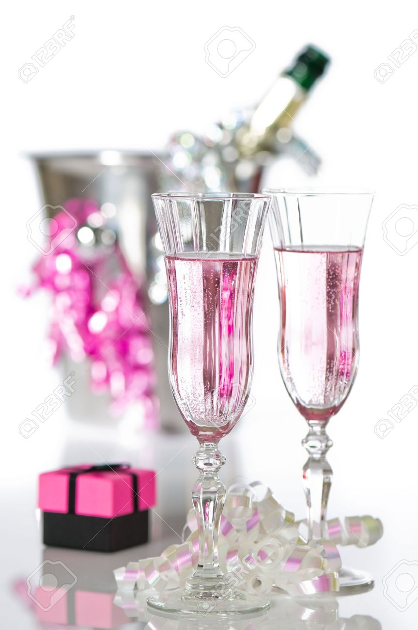 Valentine pink champagne with gift and bottle in ice bucket on white background Stock Photo - 6077538