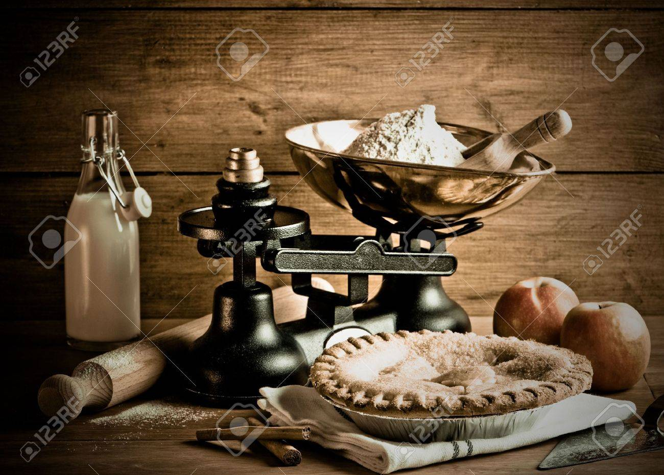 Old fashioned apple pie dessert with antique weighing scales Stock Photo - 6574961