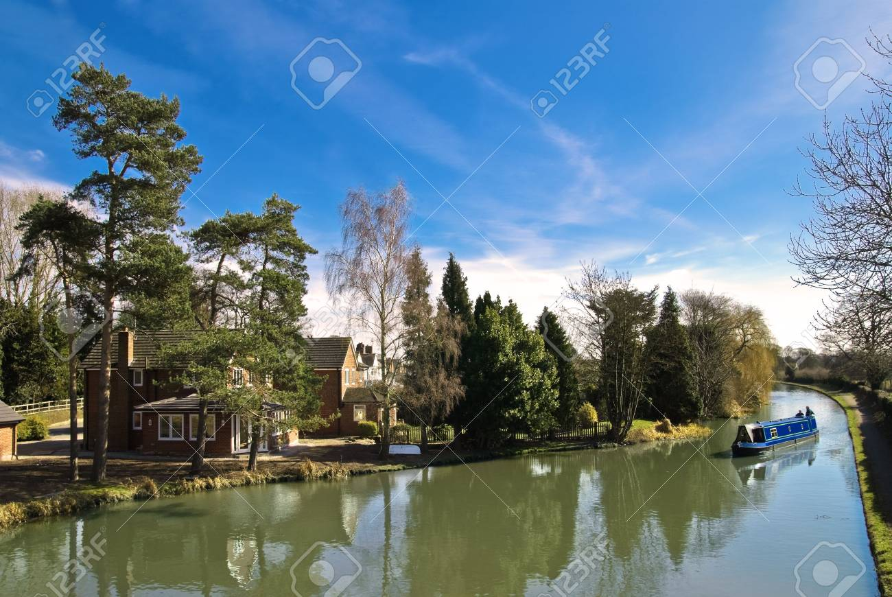 Exclusive canalside properties with narrow boat Stock Photo - 6648108