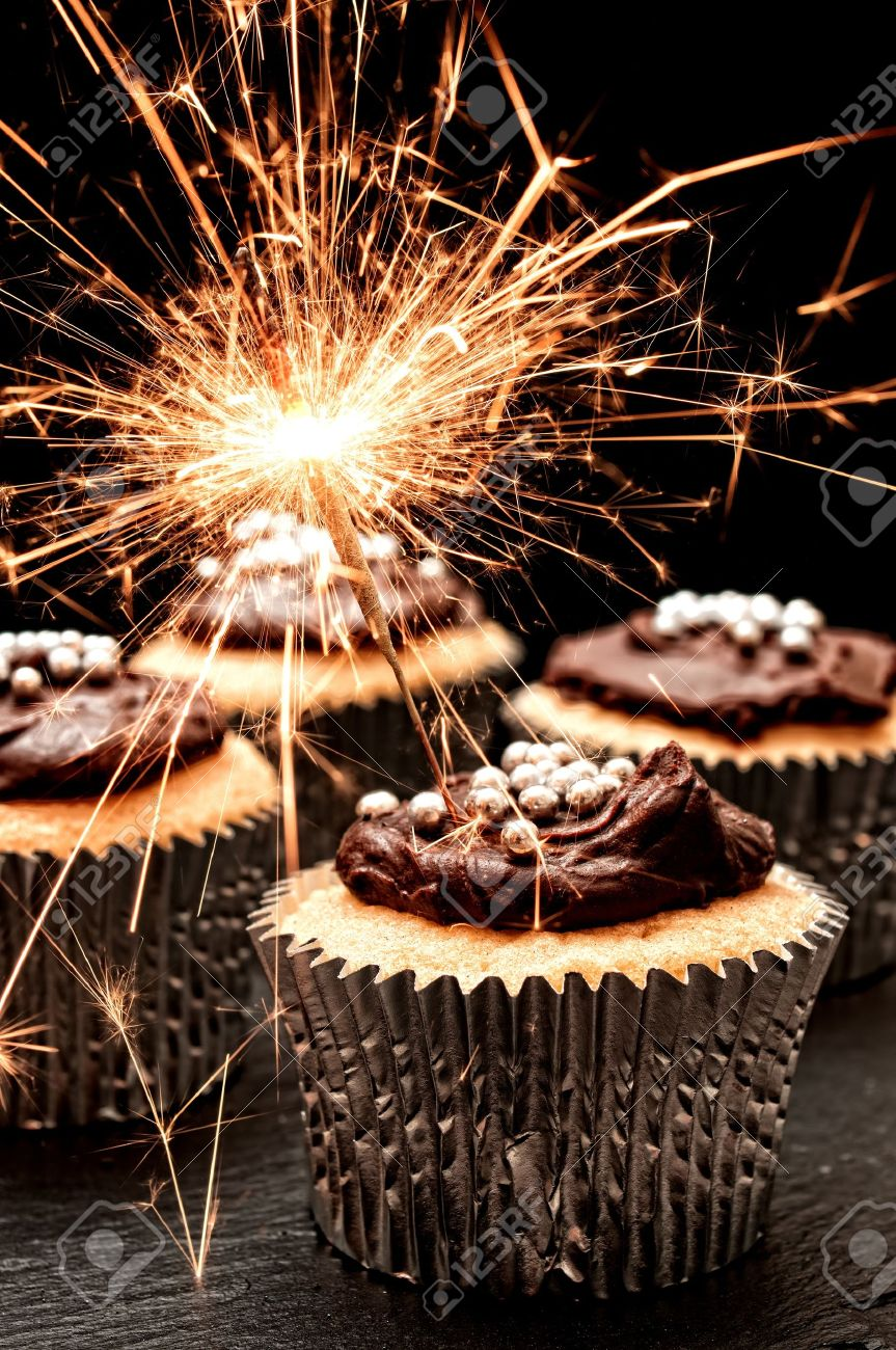 Cupcakes Decorated With Chocolate Ganache Sparklers Stock Photo