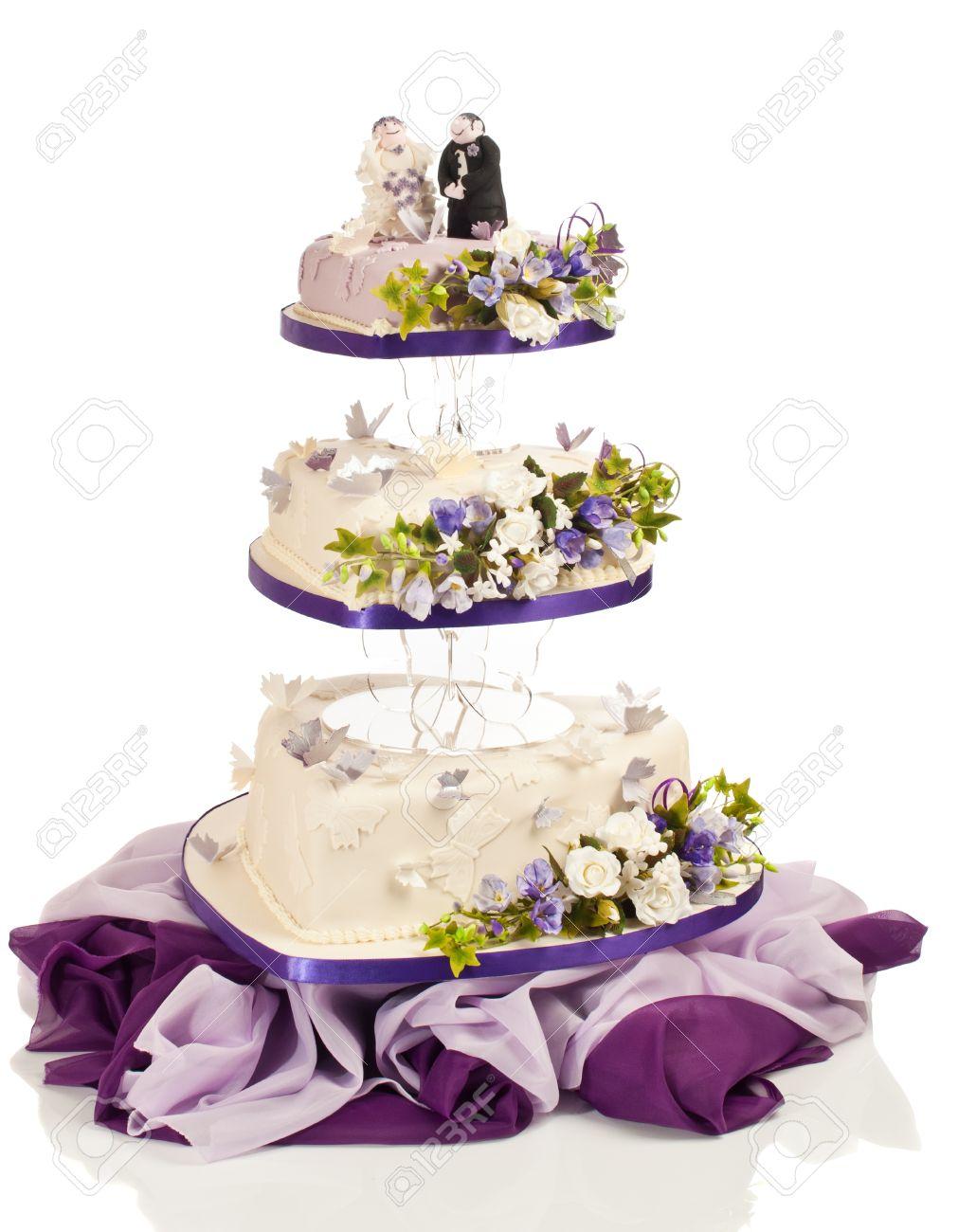 Heart Shaped Wedding Cake In Three Tiers With Flowers And ...