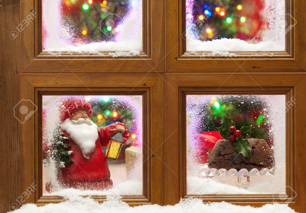 Snowy window with Christmas pudding and tree with twinkling fairy lights Stock Photo - 11151176