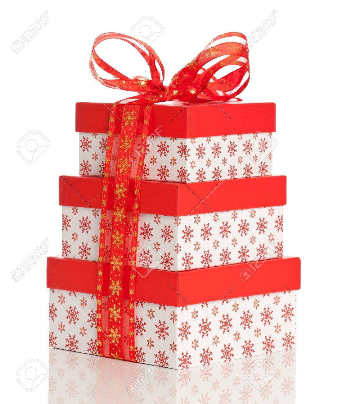 Stack Of Christmas Presents Tied With A Red Bow On A White ...