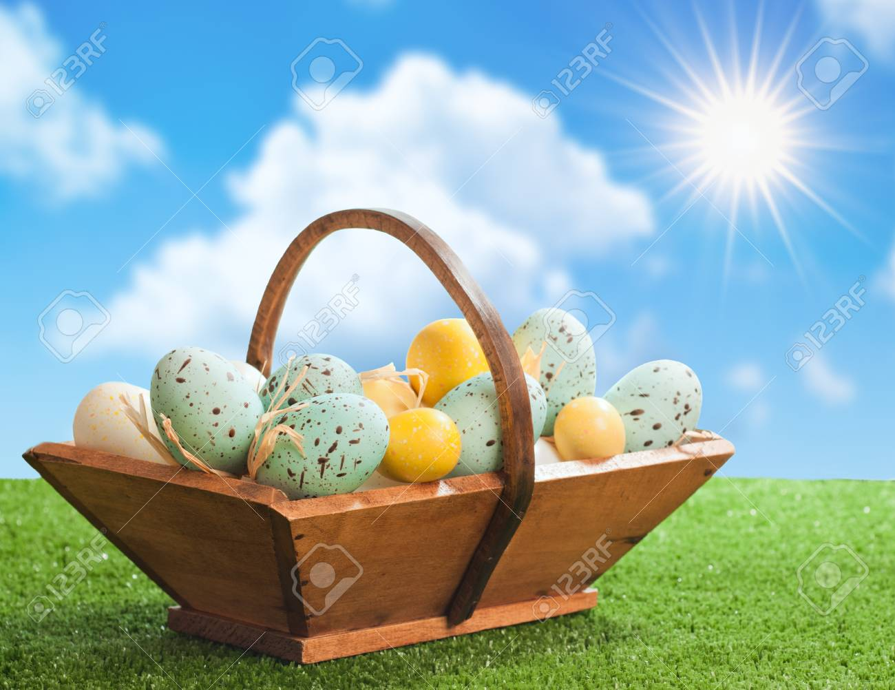 Basket of decorated Easter eggs with springtime feeling Stock Photo - 12463863