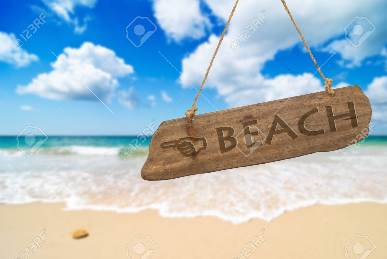 Idyllic beach with blue sky and fluffy white clouds Stock Photo - 12463878
