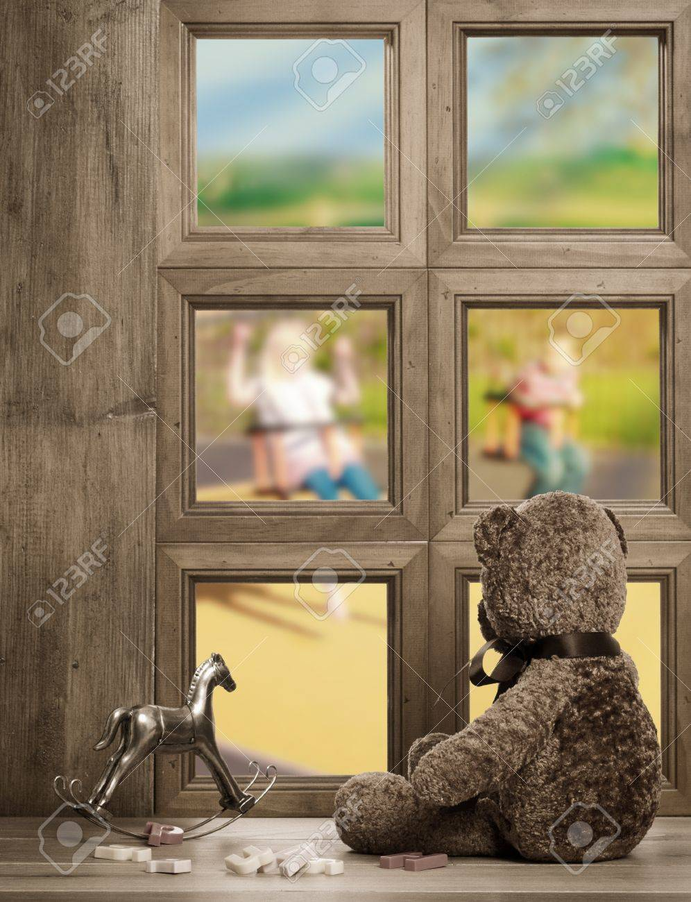 teddy bear watches from the nursery window waiting for the