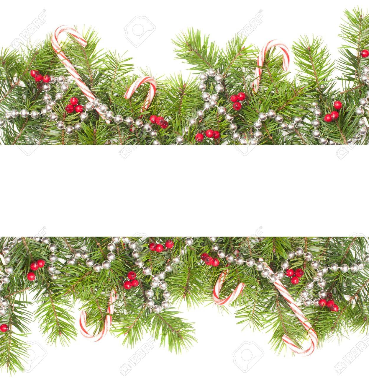 Christmas border with candy canes on a white background Stock Photo - 13956041