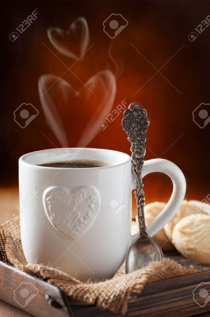 Valentine's day coffee and biscuits with focus on decorative antique spoon Stock Photo - 17331875