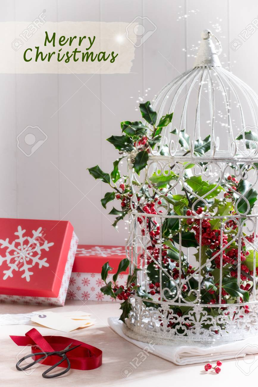 Birdcage Filled With Holly And Berries For The Christmas Holiday