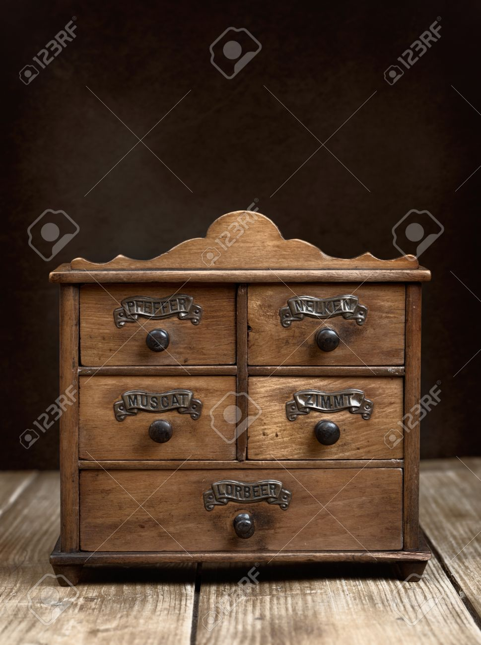 Stock Photo - Vintage spice cabinet on rustic wooden table - Vintage Spice Cabinet On Rustic Wooden Table Stock Photo, Picture