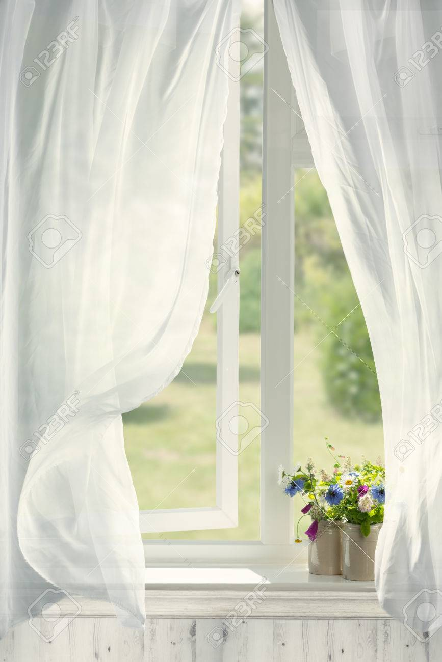 Pots of flowers in country cottage window with billowing curtains - 80179727