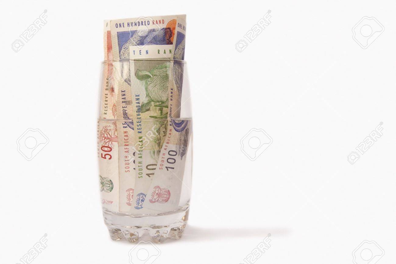 South African money in a glass of water isolated on a white background - 4497797
