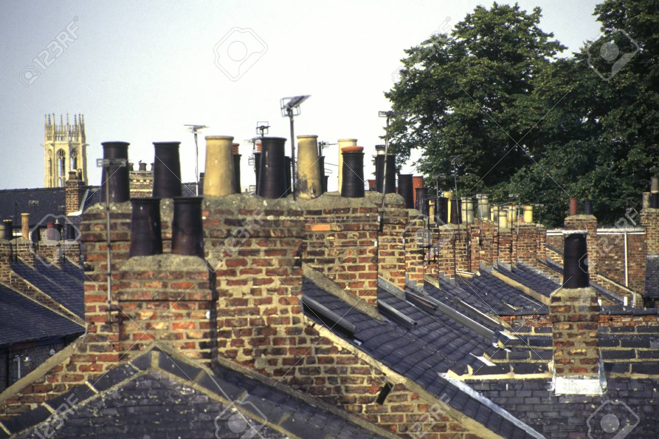 old victorian terraced house chimney stacks and chimney pots stock