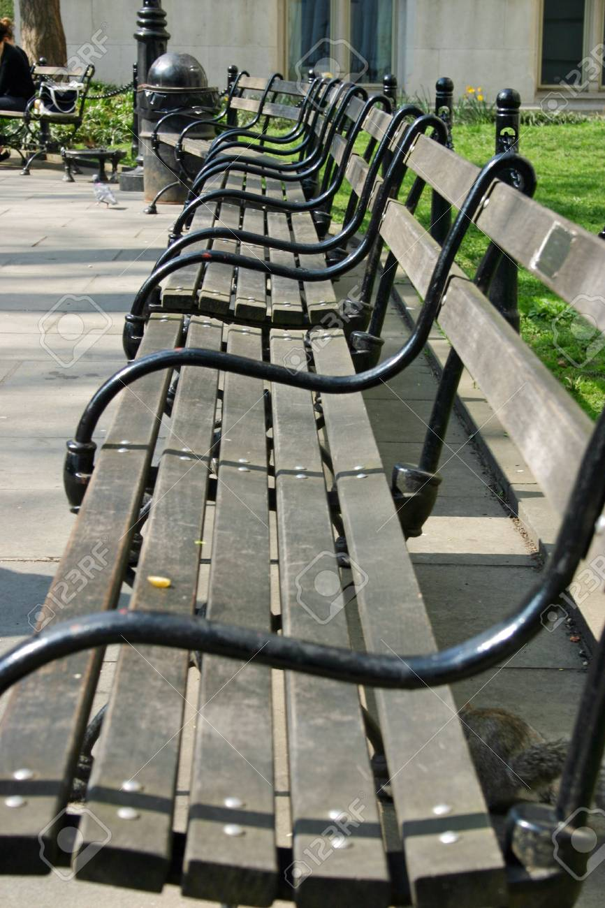 An Empty Park Bench In New York City Stock Photo Picture And