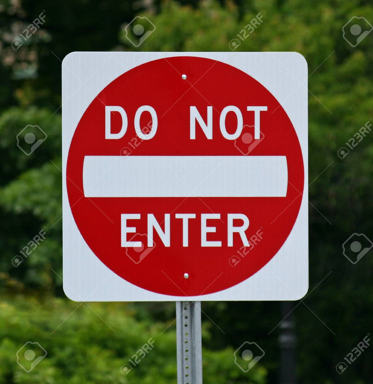 A Do Not Enter sign against a background of trees Stock Photo - 14410524