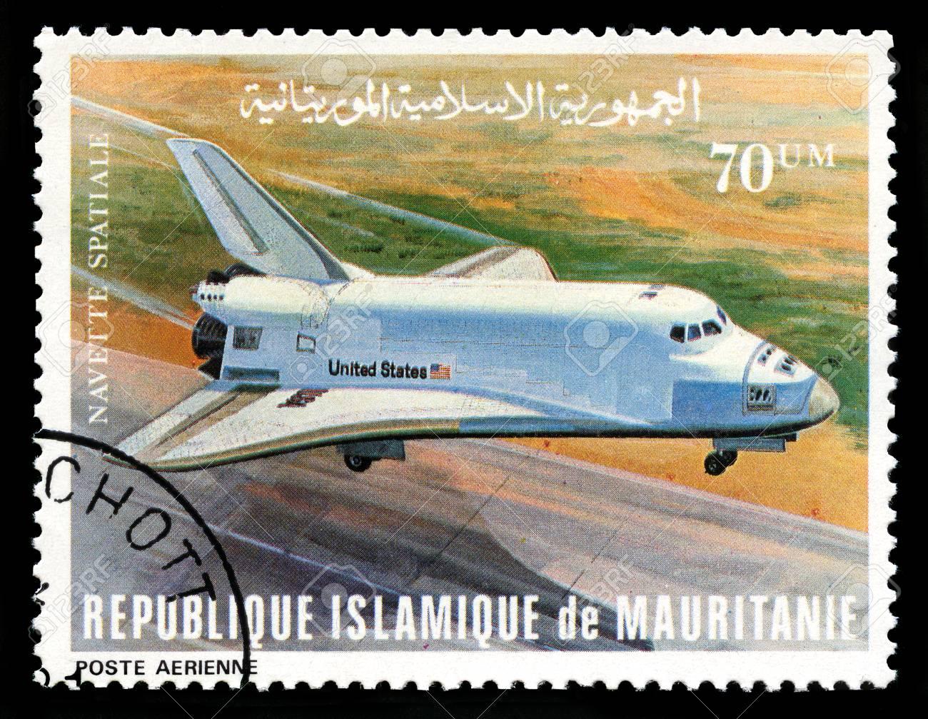 REPUBLIQUE ISLAMIQUE DE MAURITANIE - CIRCA 1981: A vintage postage stamp from Republique Islamique de Mauritanie depicting an image of the Space Shuttle, circa 1981. - 31221916