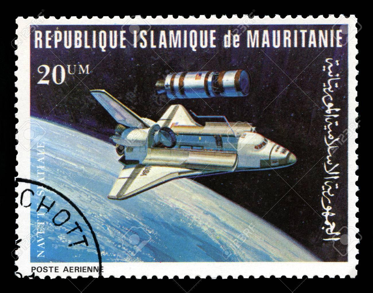 REPUBLIQUE ISLAMIQUE DE MAURITANIE - CIRCA 1981: A vintage postage stamp from Republique Islamique de Mauritanie depicting an image of the Space Shuttle, circa 1981. - 31221918