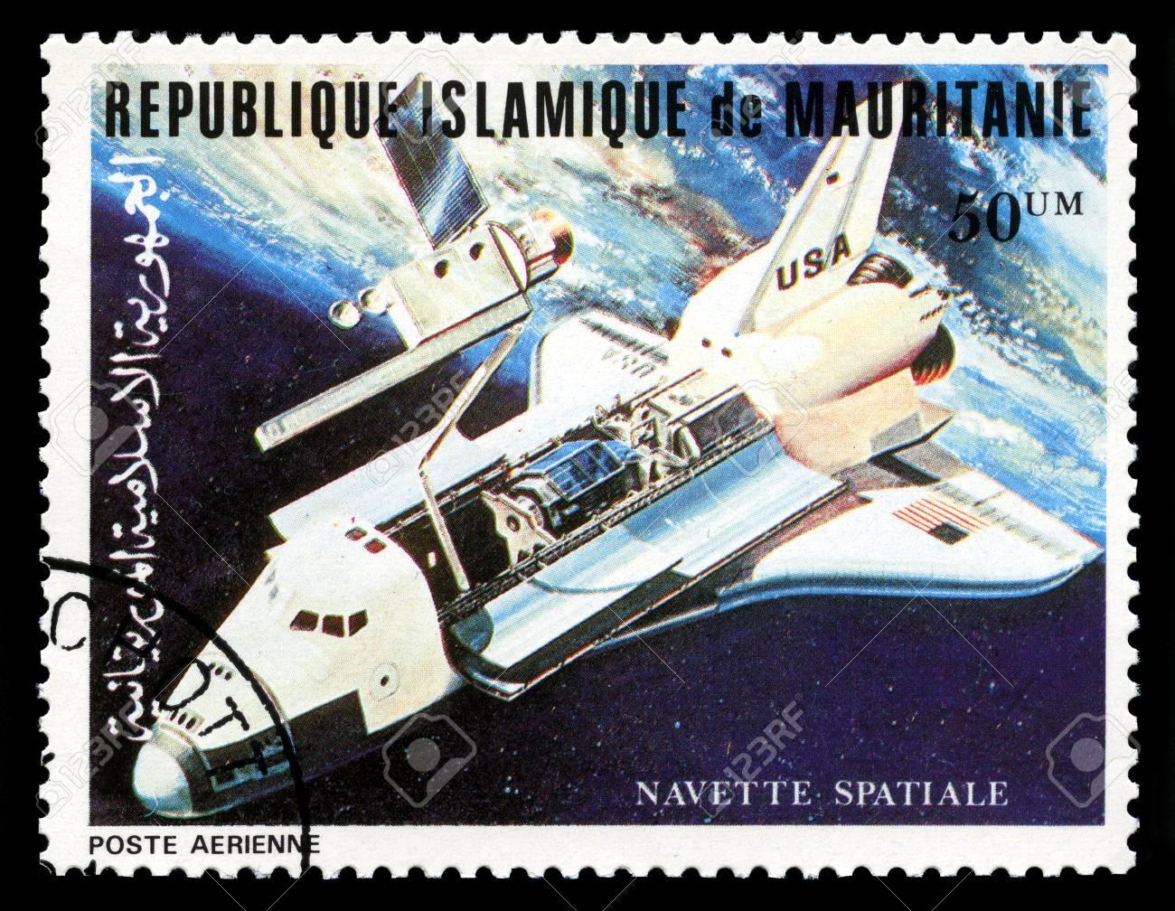 REPUBLIQUE ISLAMIQUE DE MAURITANIE - CIRCA 1981: A vintage postage stamp from Republique Islamique de Mauritanie depicting an image of the Space Shuttle, circa 1981. - 31610486