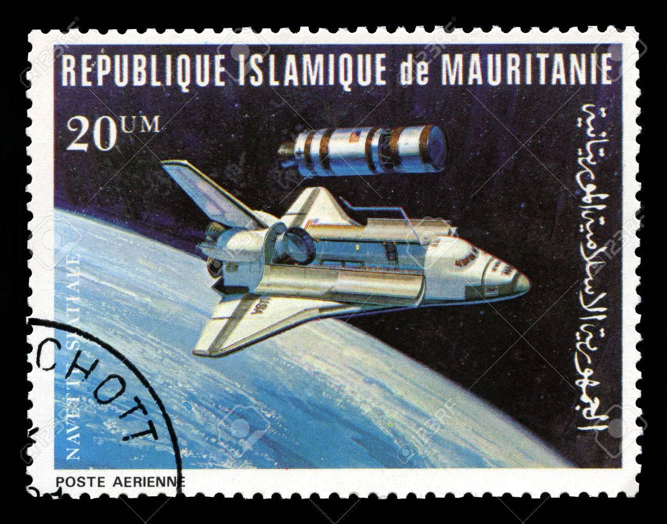 REPUBLIQUE ISLAMIQUE DE MAURITANIE - CIRCA 1981: A vintage postage stamp from Republique Islamique de Mauritanie depicting an image of the Space Shuttle, circa 1981. - 31610485