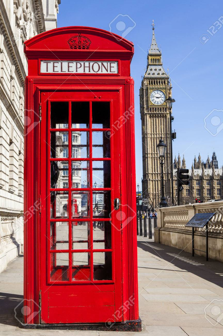 An iconic red Telephone Box with Big Ben in the background in London. - 39058226