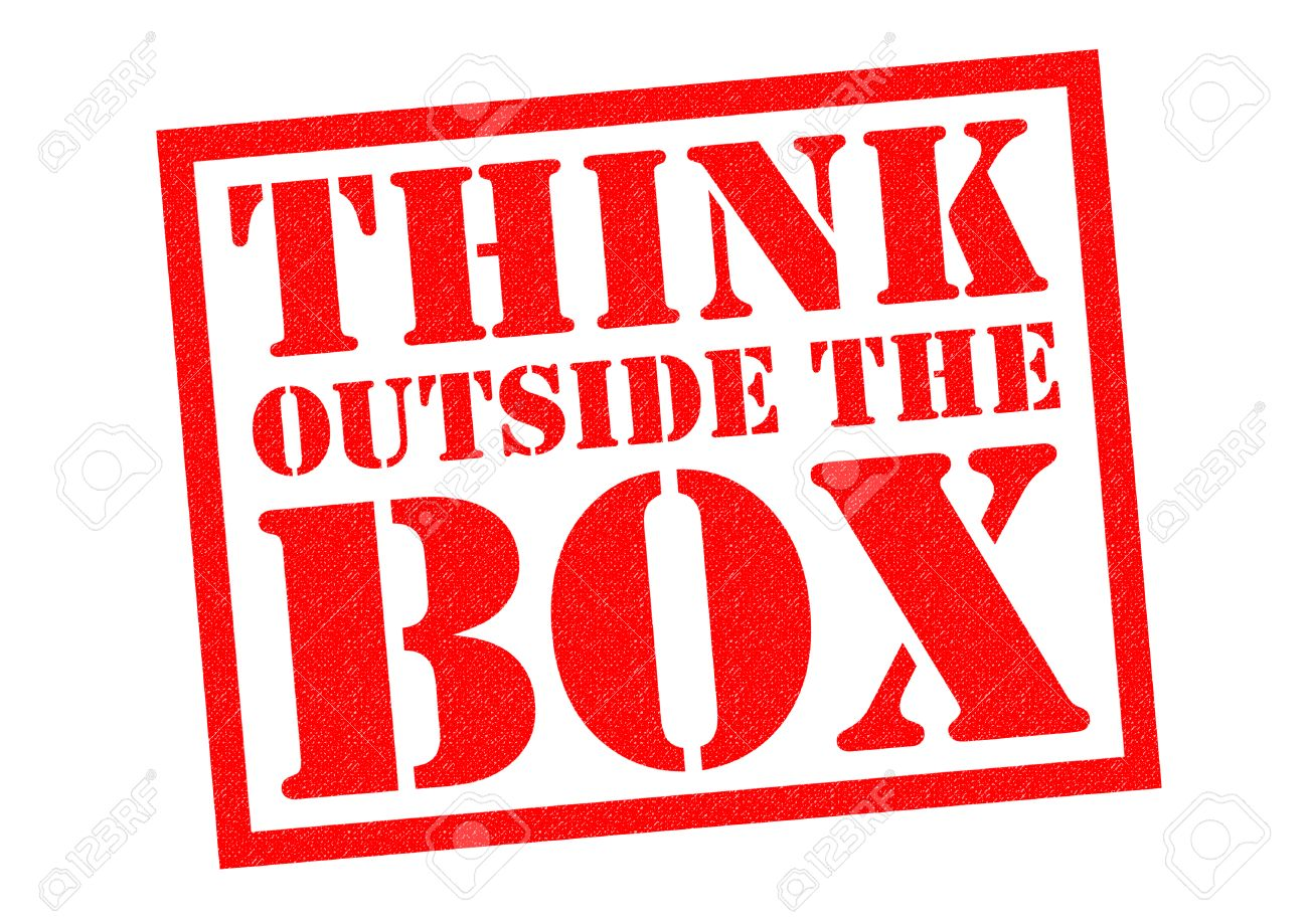 THINK OUTSIDE THE BOX Red Rubber Stamp Over A White Background Stock Photo