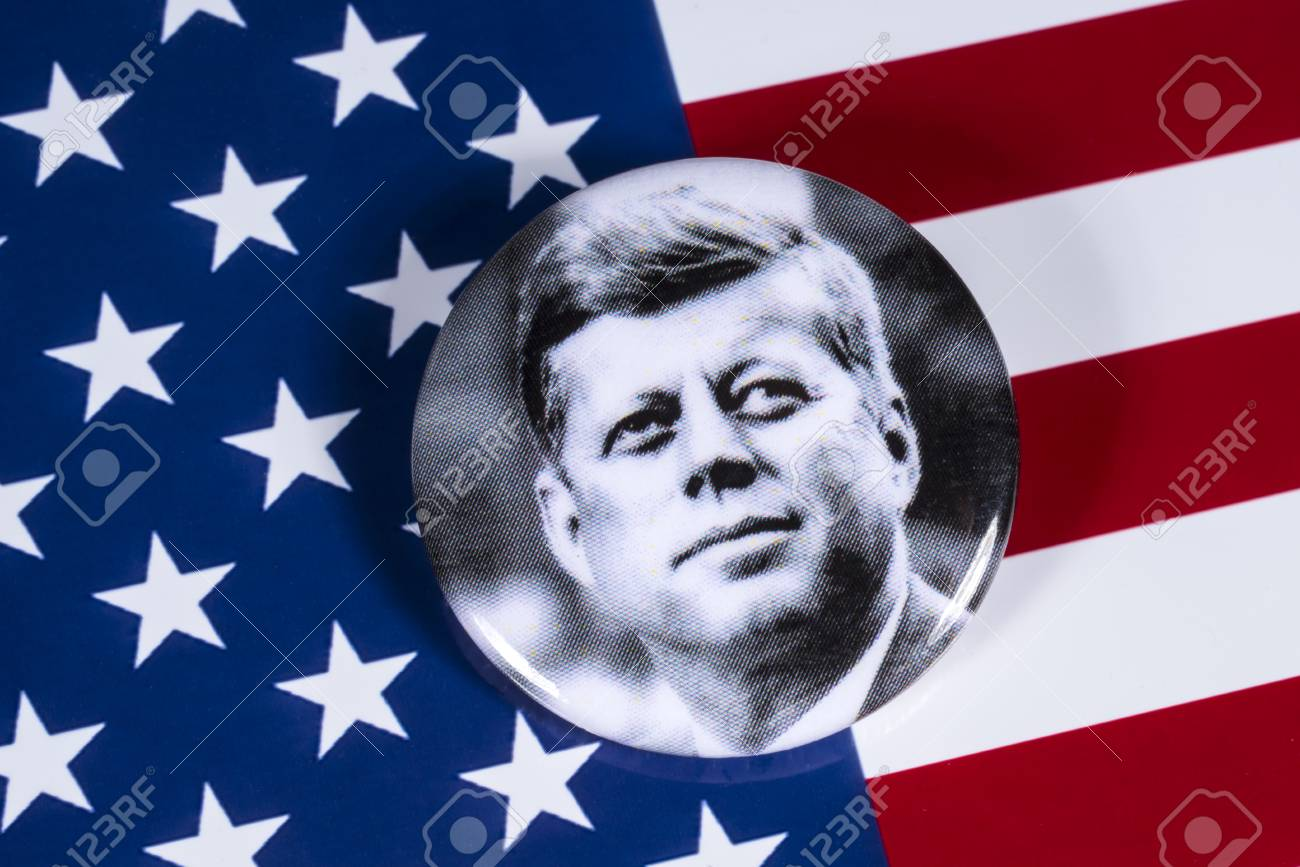 LONDON, UK - APRIL 27TH 2018: A John F. Kennedy badge pictured over the USA Flag, on 27th April 2018. John F Kennedy was the 35th President of the United States of America. - 104526627