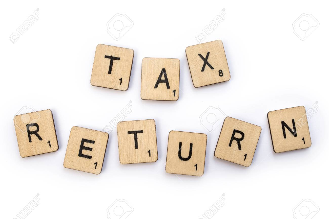 london uk july 5th 2018 tax return spelt with wooden letter
