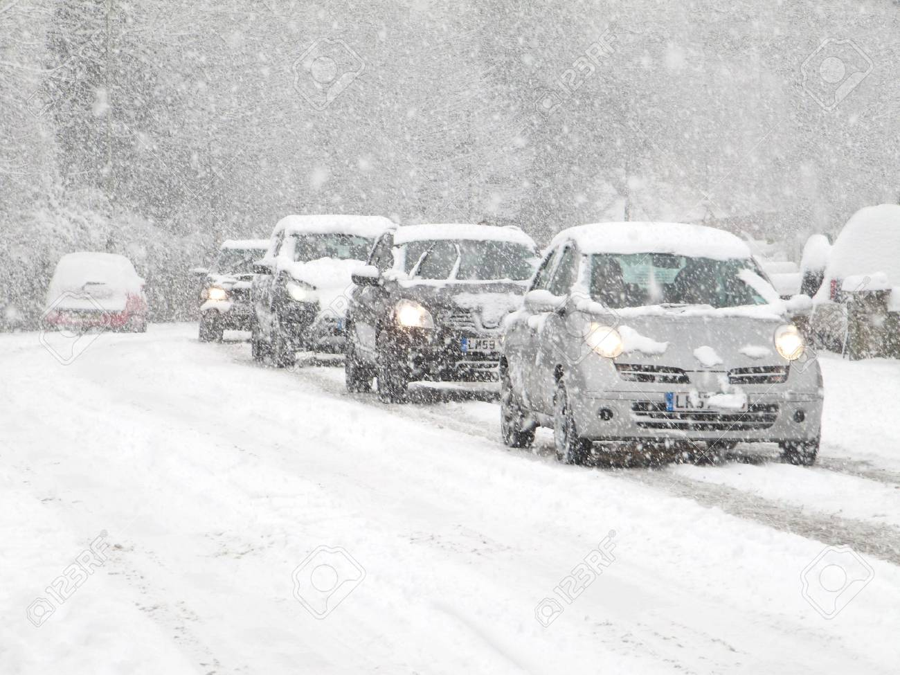 cars driving in heavy snow in england Stock Photo - 8472284