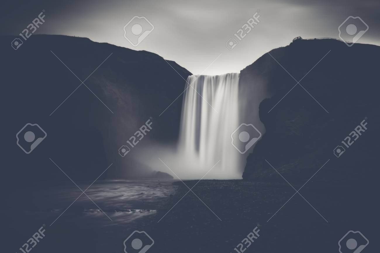 Powerful waterfall - The famous Skogafoss in Iceland, monochrome with strong contrast. Stock Photo - 51566536