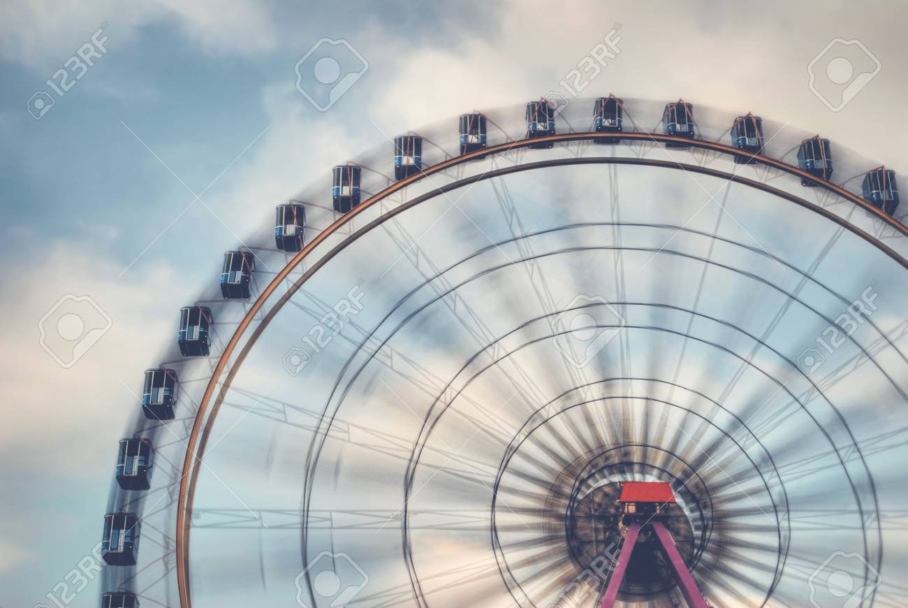Fun on the ferries wheel - Imagine to ride on a ferries wheel that is turning faster and faster ... Stock Photo - 51566546