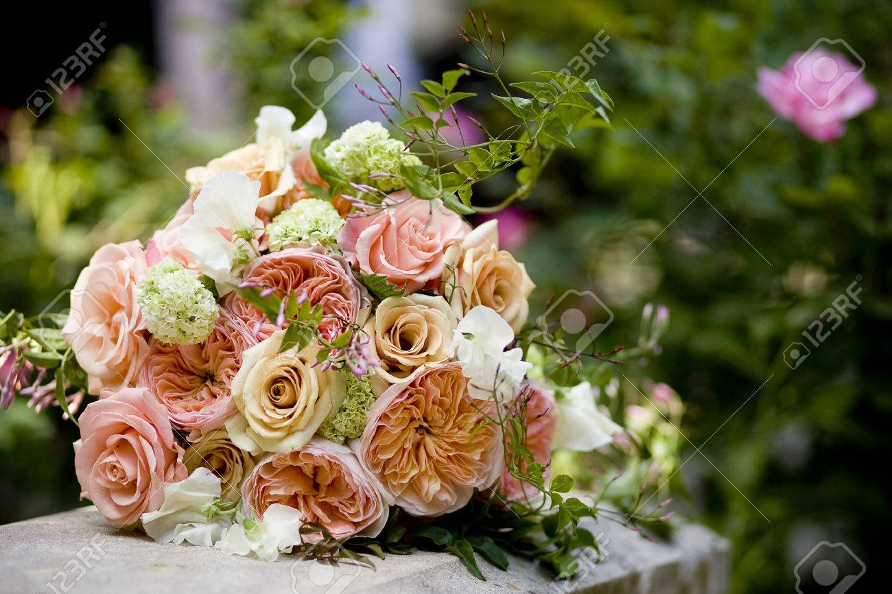 brides wedding bouquet of roses garden roses mini hydrangea sweet pea and