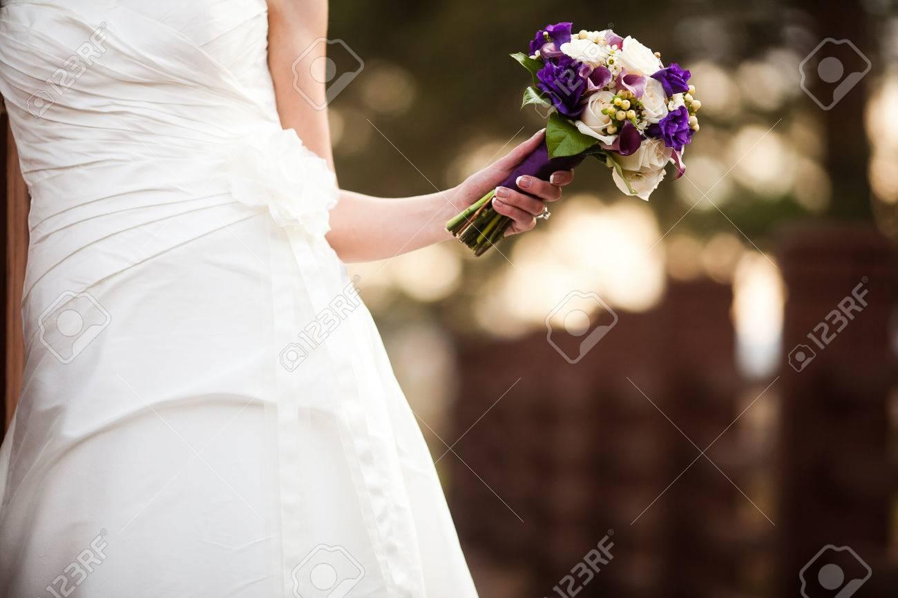 Bride Holding Wedding Bouquet Flowers With Purple Lisianthus