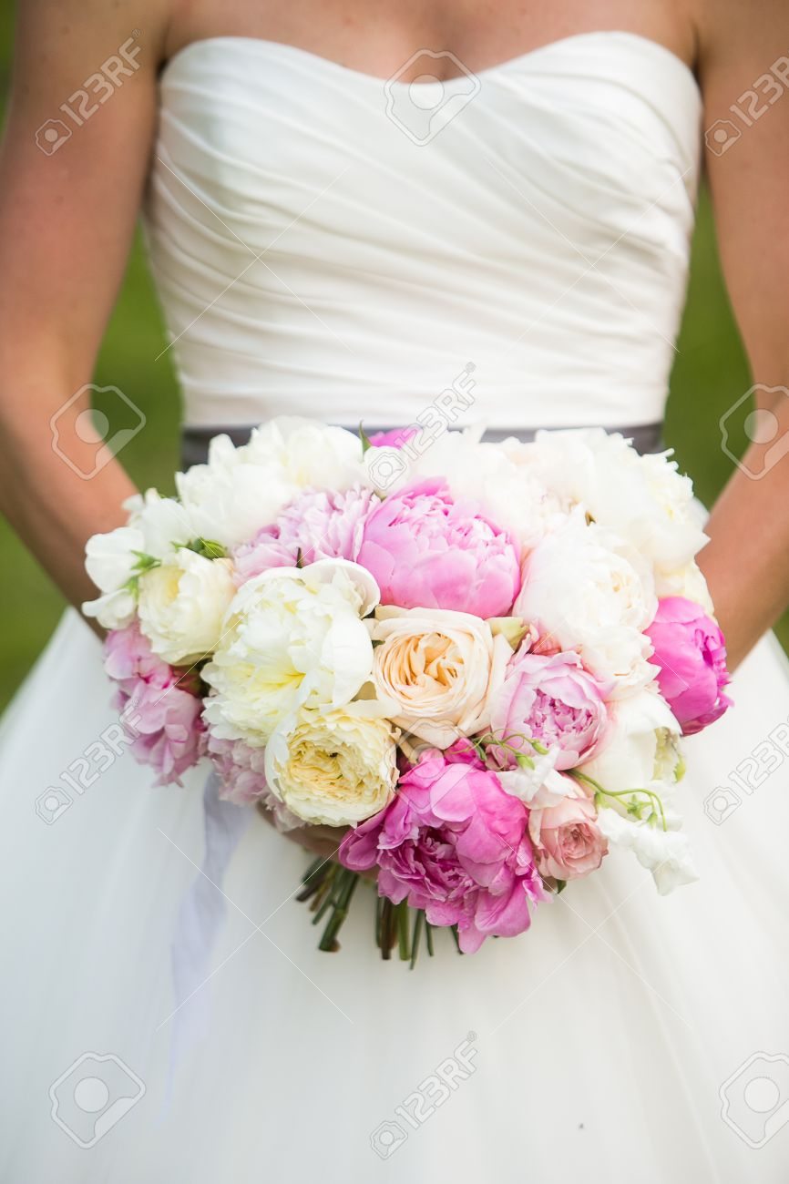 Bride Holding Wedding Bouquet With Peonies, Garden Roses, And ...