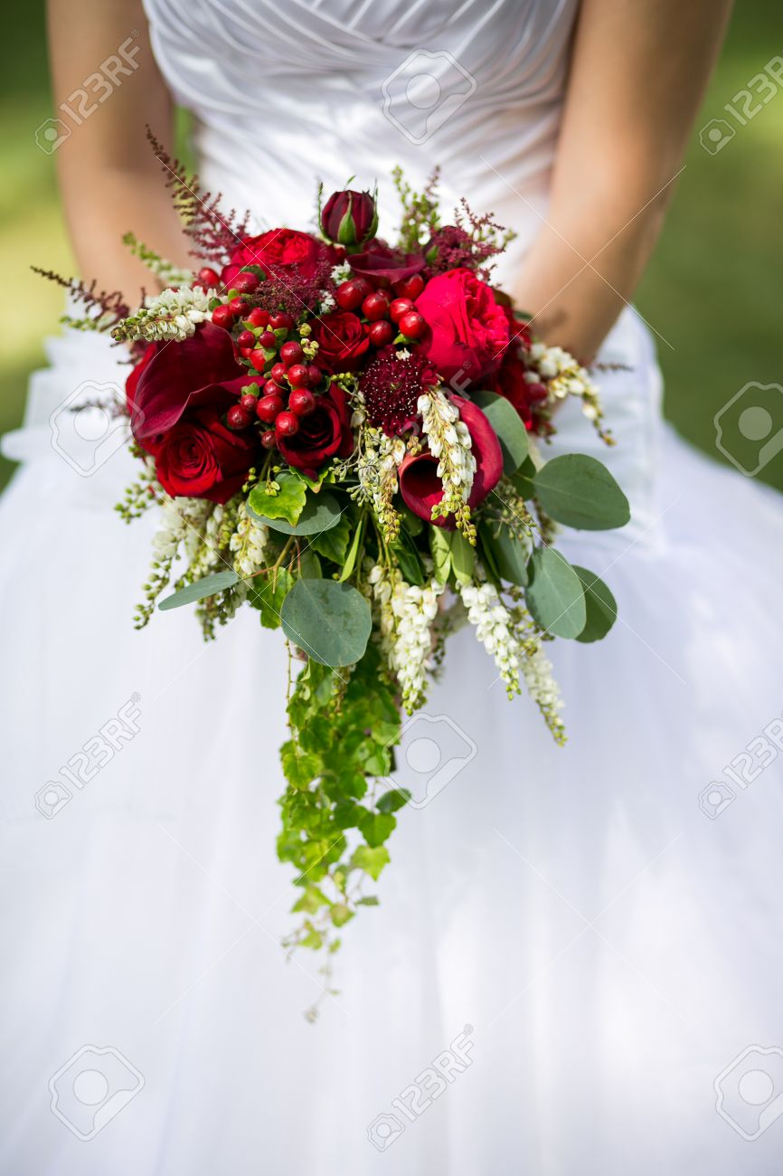 Wedding bouquet of flowers including red hypericum roses lilies wedding bouquet of flowers including red hypericum roses lilies of the valley mini izmirmasajfo