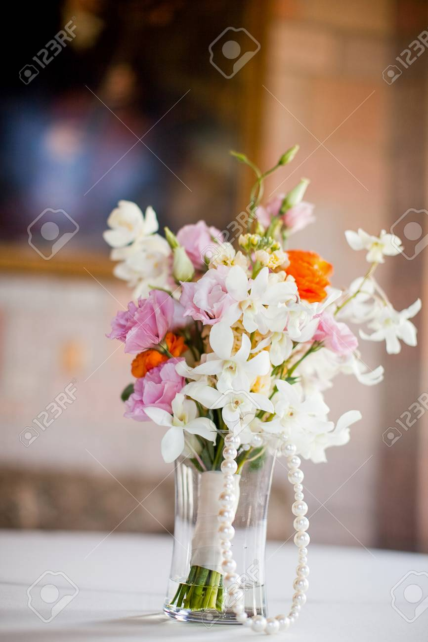 Vase of pretty flowers sitting on a table stock photo picture and vase of pretty flowers sitting on a table stock photo 44242064 reviewsmspy