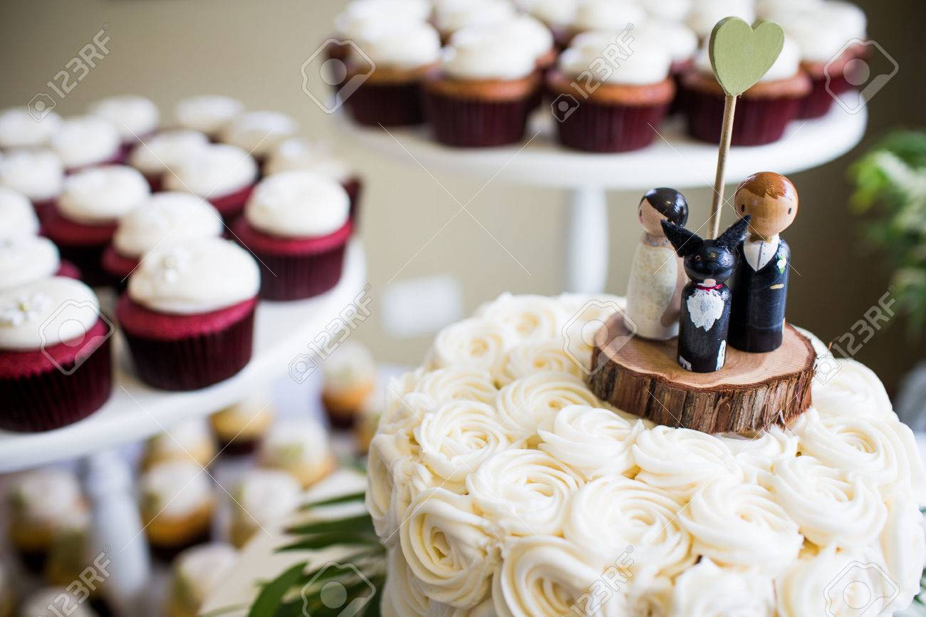 Cute Bride, Groom, And Dog Wedding Cake Topper With Cupcakes.. Stock ...