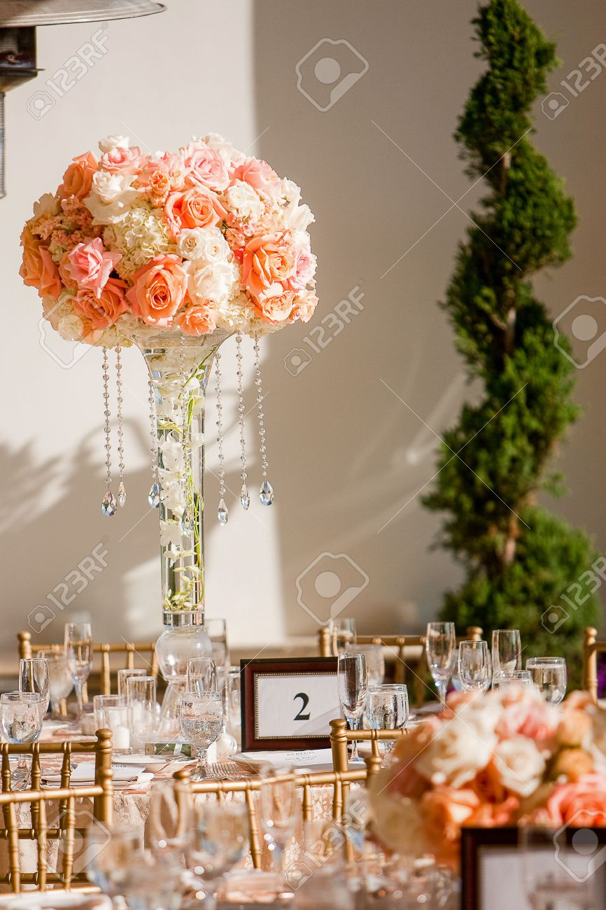 Elegant wedding centerpieces - Beautiful Centerpiece At An Elegant Wedding Reception Consisting Of White Hydrangea Peach Roses Orange